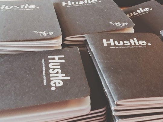 """The """"Hustle"""" pads Phat Startup handed out at its Tech808"""