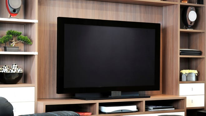 Tips on how to get you big-screen television to blend into the room.