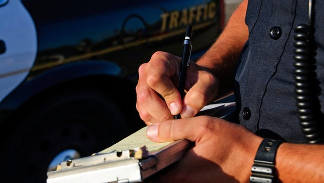 Stock image: Writing a ticket