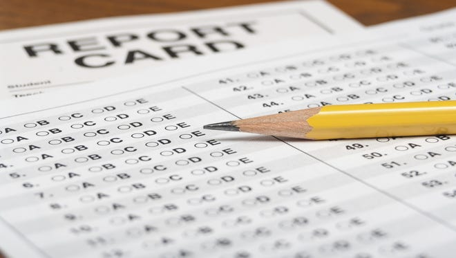 Standardized test with pencil and report card.