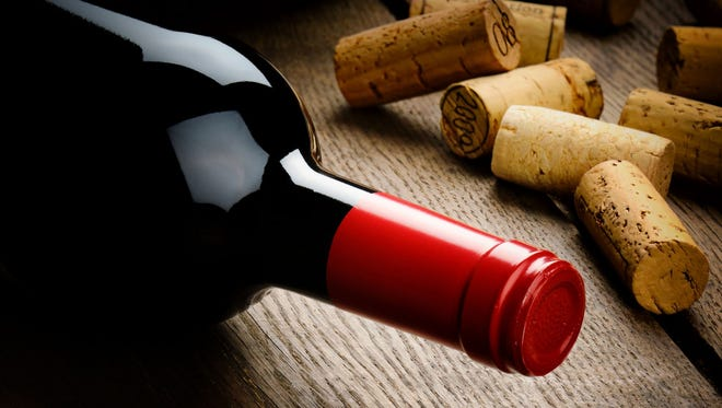 Getty Images/iStockphoto Bottle of red wine and corks
