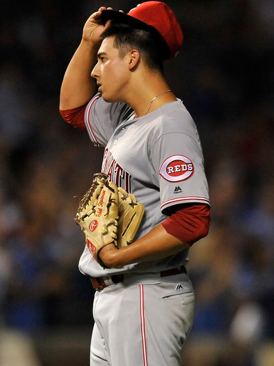 Cincinnati Reds starting pitcher Robert Stephenson reacts after giving up a solo home run to Chicago Cubs' Dexter Fowler during the fourth inning of a baseball game Wednesday, Sept. 21, 2016, in Chicago. (AP Photo/Paul Beaty)