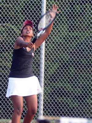 Hesston's Amala John competes in second doubles Thursday at the Hesston Invitational at the Prairie Hills Middle School courts.