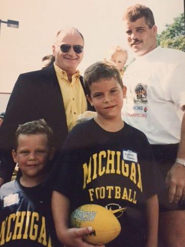 Left to right: Zach Boren, former Michigan coach Bo