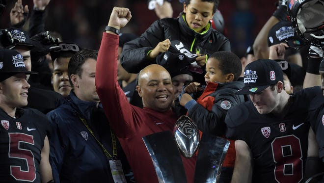Stanford coach David Shaw raises his arm after a Pac-12 title win Saturday night over USC, 41-24.