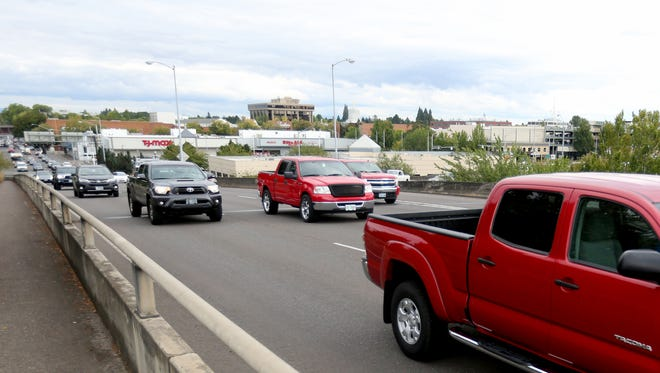 Evening rush hour traffic on the Marion Street bridge in August.