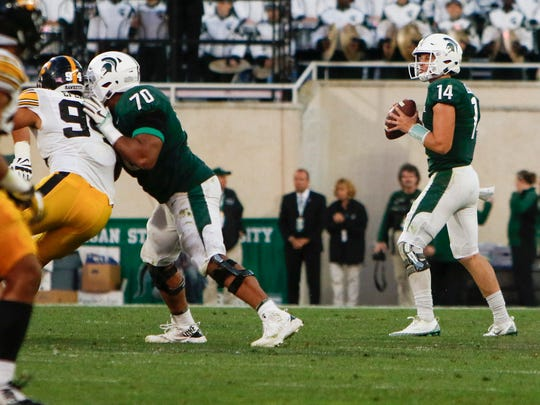 MSU OG Tyler Higby, left, and Cole Chewins provide pass protection for QB Brian Lewerke Saturday, Sept. 30, 2017, against Iowa at Spartan Stadium in East Lansing.