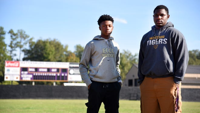 OÕRrion Bailey and C.J. Anderson stand in Hattiesburg High School's Smokie Harrington Park on Thursday. The two Hattiesburg High seniors are ready to play in their first home stadium in February.