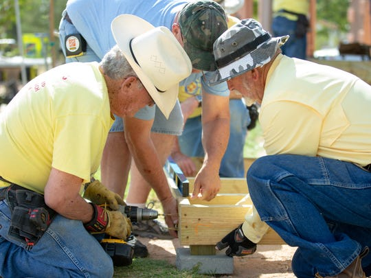 Lonnie Mathews, left, Gary Uithoven, center, and Jim Martin work to build a ramp at a home in Chaparral on Saturday, June 2, 2018.