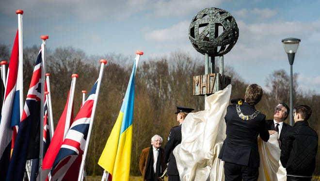 The unveiling ceremony of a monument in memory of the victims of the doomed Malaysia Airlines flight MH17 at Eindhoven airport, The Netherlands, March 24, 2018.