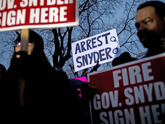 Gov. Rick Snyder has been targeted by protesters in Lansing, his home in Ann Arbor and Flint, above, over his administration's handling of the water crisis.
