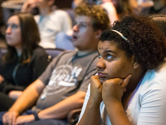 Brecarea Hunt (right), 18, listens in her Chandler High government class as a judge tells of the legal responsibilities that come with turning 18.