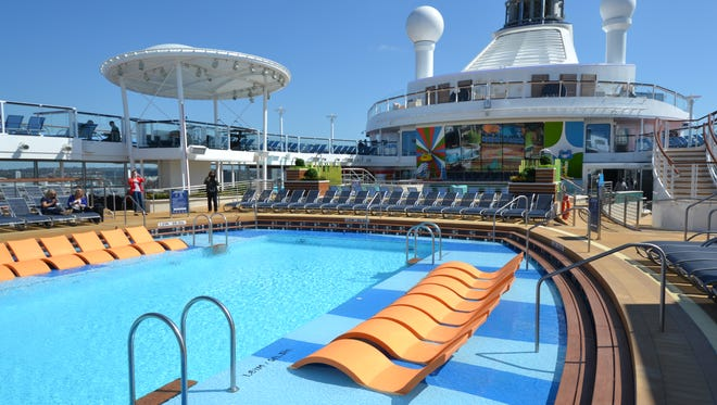 The top deck of Anthem of the Seas features a large main pool area open to the sky.