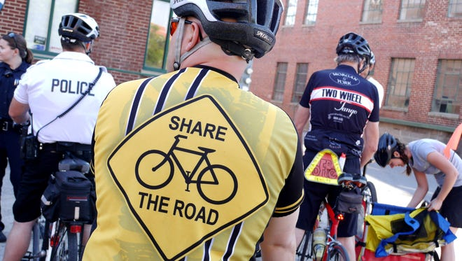 "About 30 riders took part in The Ride of Silence in Staunton Wednesday, May 20, 2015. The ride is to honor cyclists who have died while riding and to raise awareness of cyclists sharing the roads. Alex Tillen wears his ""share the road"" jersey for the ride."