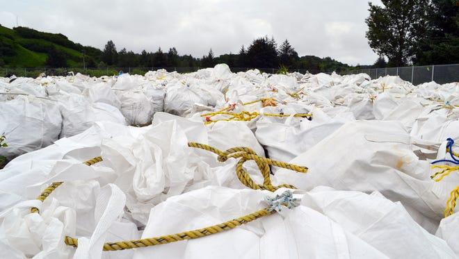 Bags of debris gathered off the coast are shown in Kodiak, Alaska.