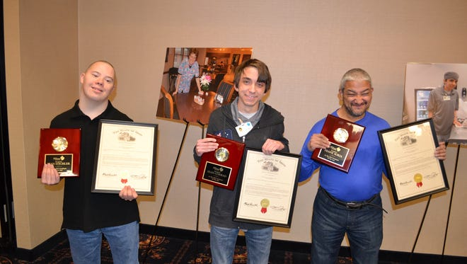 Sean Stichler, Sean Conrad and Frank Soria received Employee of the Year awards Thursday at a Richland Newhope Industries recognition breakfast.