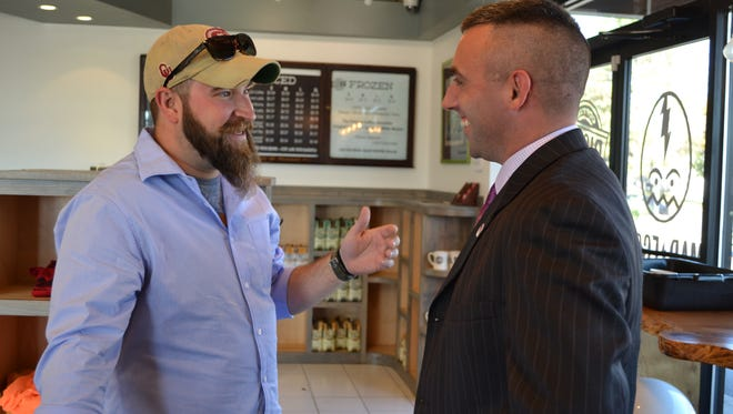 Salisbury Mayor-elect Jake Day, right, chats with Ryan Weaver during an Election Day stop at Rise Up Coffee.