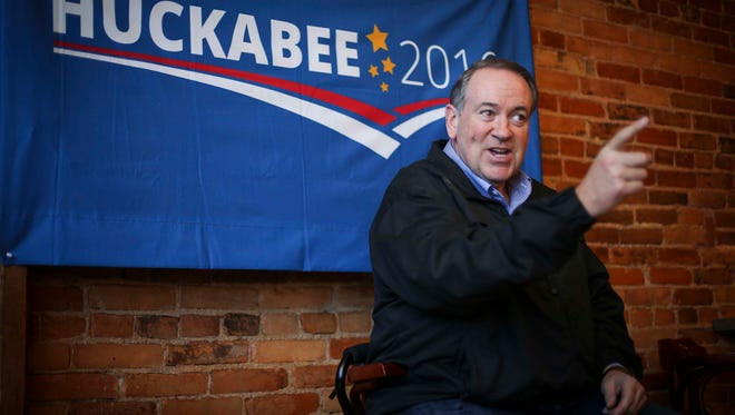 Former Arkansas Gov. Mike Huckabee campaigns at the Albia Brewing Co., on Thursday, Nov. 19, 2015, in Albia, Iowa.