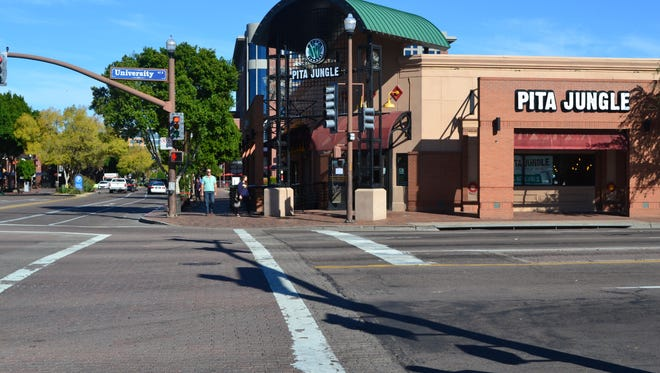 The new Pita Jungle Tempe sits at the busy intersection of University Drive and Mill Avenue, the entrance to downtown Tempe.