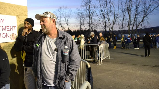 Russell May, 55, from Binghamton, stands in line at Binghamton's Best Buy Thursday before the store opened at 5 p.m. He, like many others waiting in the line, said it was his first Thanksgiving Day/Black Friday shopping experience and he was most interested in buying a new TV. Warm weather on Friday also sparked crowds and long lines in the area.