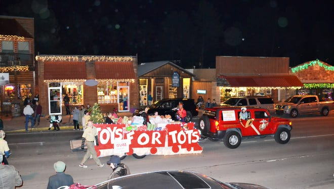Toys for Tots partners with the Chamber of Commerce in the Festival of Lights parade and collects toy donations along the route.