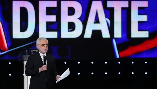 CNN anchor Wolf Blitzer speaks before the first round of the CNN Republican presidential debate on Tuesday in Las Vegas. This is the last GOP debate of the year, with U.S. Sen. Ted Cruz (R-TX) gaining in the polls in Iowa and other early voting states and Donald Trump rising in national polls.