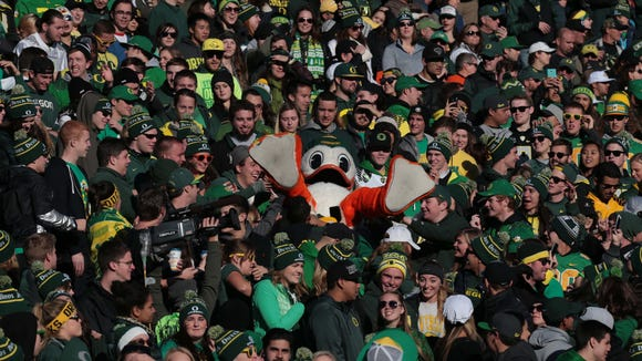 Nov 27, 2015; Eugene, OR, USA; Oregon Ducks mascot is lifted into the air form fans against the Oregon State Beavers at Autzen Stadium. Mandatory Credit: Scott Olmos-USA TODAY Sports