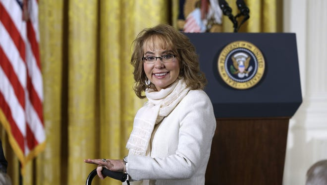 Former Arizona Rep. Gabby Giffords arrives in the East Room of the White House in Washington, Tuesday, Jan. 5, 2016, prior to President Barack Obama's announcement of a more sweeping definition of gun dealers that the administration hopes will expand the number of gun sales subject to background checks. (AP Photo/Carolyn Kaster)