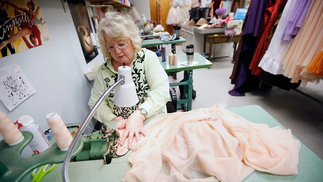 Diana Vandergriff-Adams, costume mistress for the Cincinnati Ballet works on a fairy costume for the ballet's upcoming production of Cinderella. Performances of Cinderella will be February 12 - 14 at the Aronoff Center for the Arts. Vandergriff-Adams has worked for the Cincinnati Ballet for 43 years.