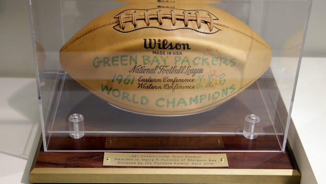 A 1961 championship team autographed football donated by the Purinton family, rests in the Packers Hall of Fame display case April 8,  2016. The ball has 40 autographs from the 1961 roster.