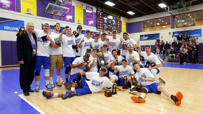 New Paltz men's volleyball team poses after winning the NCAA Division III title on Sunday.