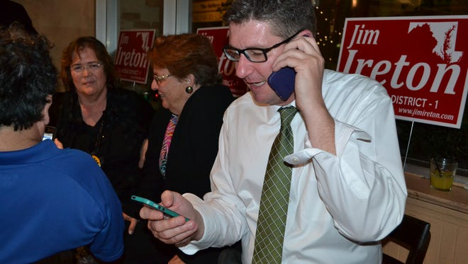Jim Ireton talks to a campaign worker during an Election Night party.