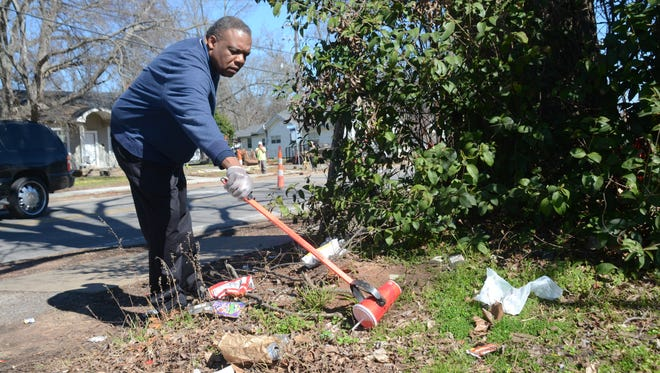 "Alexandria City Councilman Roosevelt Johnson, shown cleaning up trash in this file photo, says Saturday morning's ""Community Cleanup Day in South Alexandria"" will proceed if it is not raining. Volunteers are asked to meet at 8:30 a.m. Saturday at Antioch Missionary Baptist Church, 2308 Houston St. If it is raining at that time, the cleanup will be delayed until Saturday, June 25."