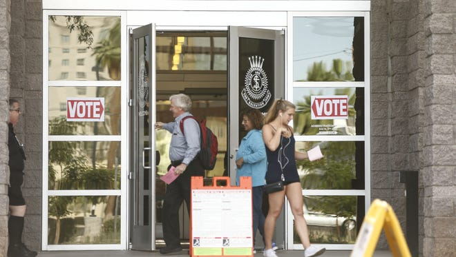 Phoenix residents walk in to vote during the May 17 Arizona special election polling place at the Salvation Army Phoenix Citadel Corp.