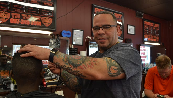 Enrique Munoz, 53, of Binghamton, owns New York Styles barbershops in Endicott and Johnson City.