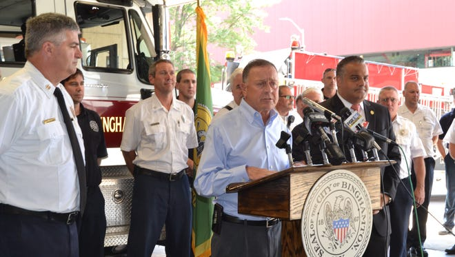 U.S Rep. Richard Hanna, center, Binghamton Mayor Richard David, right, and Fire Chief Daniel E. Eggleston took part in a news conference Wednesday  at the Hawley Street fire station, calling on Congress to support the Firefighter Cancer Registry Act.