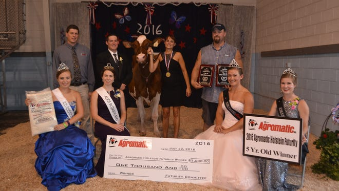 The winner of the 5-year-old class at the Agromatic Holstein Futurity was Westphal-Elg R Madhouse-Red, owned by Brandi and Eric Westphal, far right. Joining them, from row from left, are Alexis Newton, 2016 Fond du Lac County Fairest of the Fair; Ann O'Leary, Wisconsin 69th Alice in Dairyland; Katie Kindschuh, 2016 Wisconsin Holstein Princess; Paige Nelson, 2016 Wisconsin Holstein Princess Attendant. Back row, from left, Jeff Liner, representing Agromatic Inc.; judge Jeff Brantmeier; Madhouse-Red, and the Westphals.