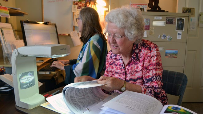 Sylvia Woodall (left) and her mother, Alma Gordon, work to translate a book into Portuguese for the 80th anniversary of the hospital founded by the Gordon family in Brazil. Gordon wrote a book about the family's history a couple of years ago.