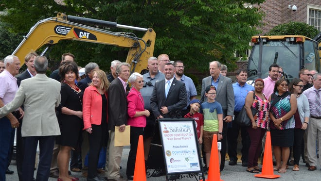 City and county officials and business owners pose with Salisbury Mayor Jake Day during a ceremonial groundbreaking for the city's Main Street improvement project on Thursday, Sept. 15, 2016.