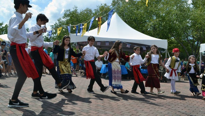 The dance group Palamakia, made up of Anderson youth of Saint George Greek Orthodox Cathedral in Greenville, performs traditional Greek dances Saturday at the Anderson Greek Festival.