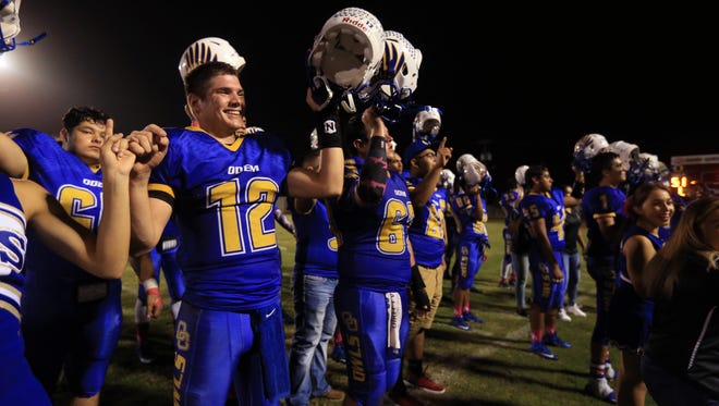 Odem quarterback Michael Everett (12) and the Owls clinched no worse than a tie for the District 16-3A Division II title by beating Hebbronville Friday night.