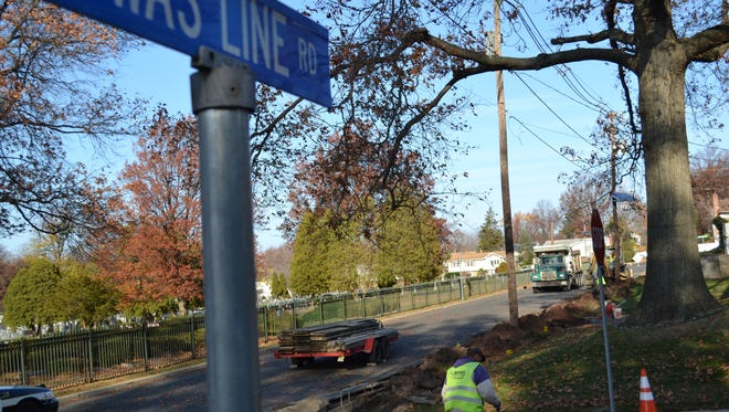 Work crews installing the much-discussed sidewalks on Clifton's Dwas Line Road in December.