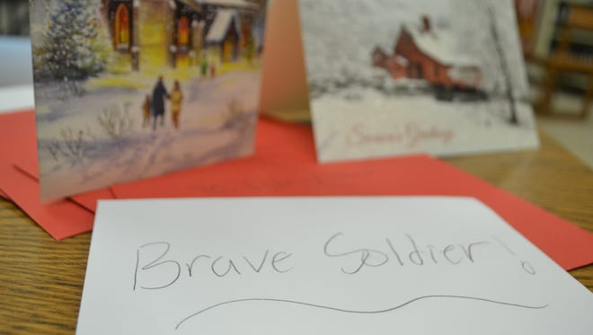 """Westside High School students wrote notes and addressed them to """"Brave Soldiers"""" overseas."""