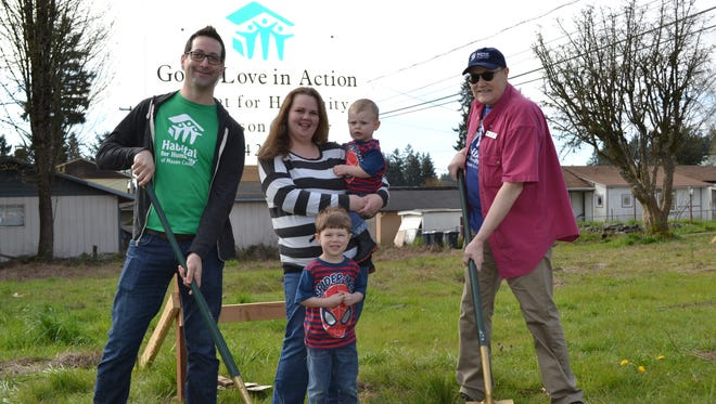 From left, Andrew Bertrand, board president of Habitat for Humanity of Mason County, Shelton resident Britni Twidwell with sons Trenton, 2, and Jeremiah, 3, and Shelton Mayor Gary Cronce celebrated the groundbreaking of Twidwell's Habitat for Humanity home in April of last year. Twidwell will move into her house this month after completing 400 hours of sweat equity to build her home.