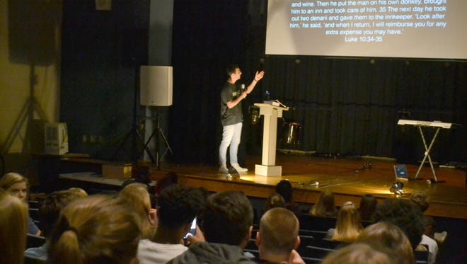 T.L. Hanna senior Clark Long speaks to about 40 students about loving others as part of The Chill service Friday morning.