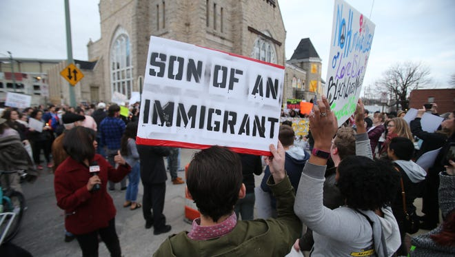 Concerned citizens participate in a march in Memphis last month organized by Refugee Empowerment Program, Comunidades Unidas en Una Voz and the Tennessee Immigrant & Refugee Rights Coalition. The march was in response to President Donald Trump's controversial immigration executive order.