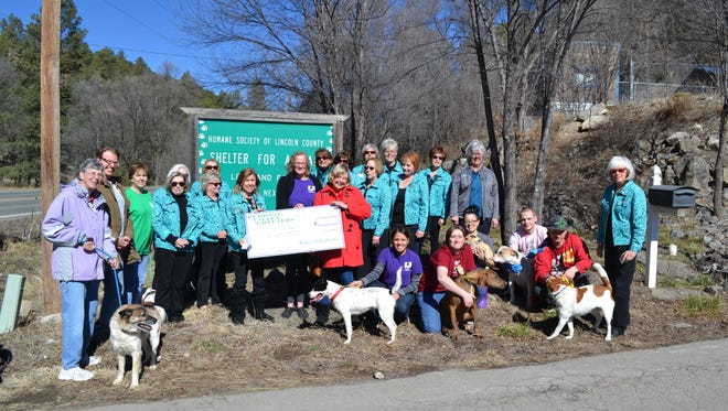 Greeters and Humane Society of Lincoln County officials pose Thursday with a Greeter donation to HSLC's spay/neuter program.