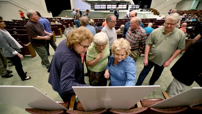 Donna McClure, Alice Mote, and Jill Anderson look at de-annexation study presentation boards during a public input meeting on possible de-annexation held by the city of Memphis at First Assembly of God church in Cordova. The Memphis City Council approved the de-annexations of Southwind-Windyke and Rocky Point on Sept. 26, 2018.