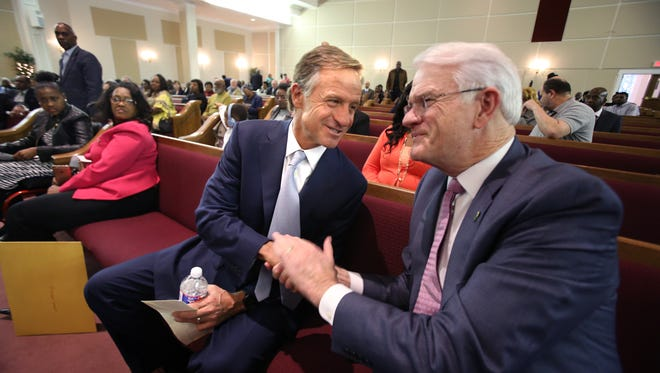 Gov. Bill Haslam greets Shelby County Mayor Mark Luttrell during a citywide town hall meeting at Greater Mount Moriah Baptist Church.