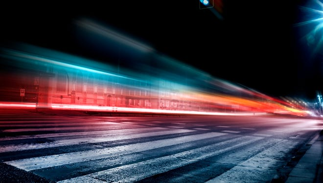 Blurred car lights in a night scenery of the city